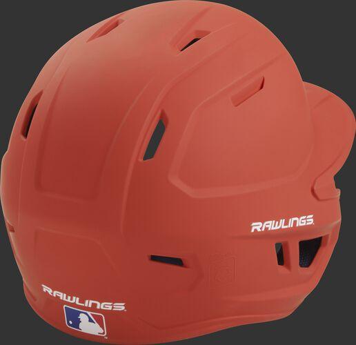 Back right of a one-tone matte burnt orange MACH Rawlings batting helmet