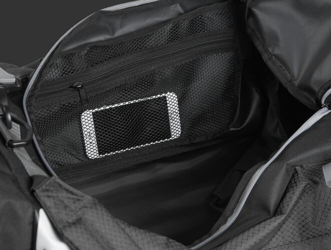A phone inside the mesh accessory pocket inside the main compartment of a black R601 Hybrid bag