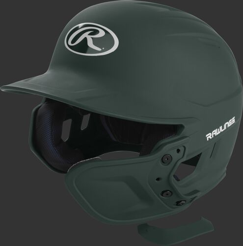 A matte dark green MEXT attached to a Mach batting helmet showing the hardware