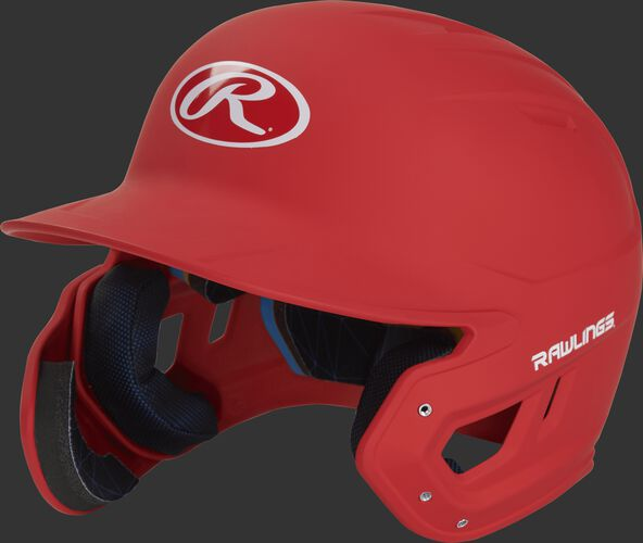 Left angle view of a MACHEXTL Rawlings Mach EXT Senior helmet with a one-tone matte scarlet shell