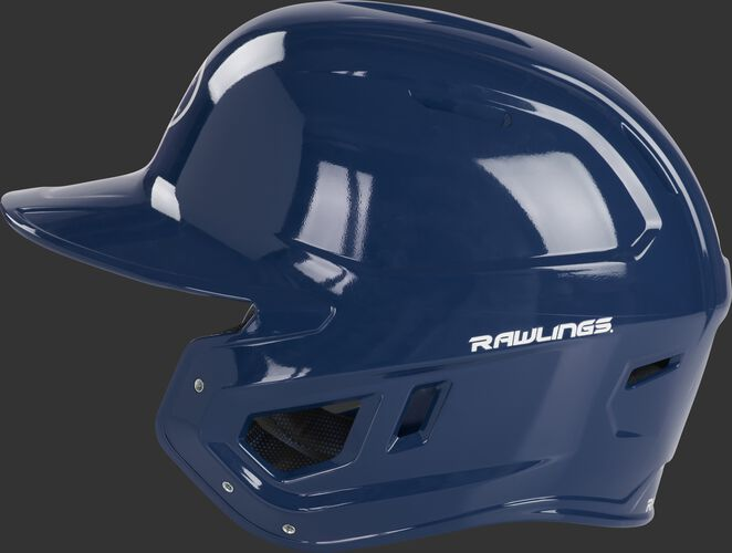 Left side of a navy MCC01 Mach baseball helmet compatible with MEXT face guard extension