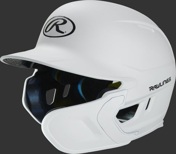 Left angle view of a matte white MACHEXTR Mach Junior helmet with Mach EXT right hand batter face guard extension