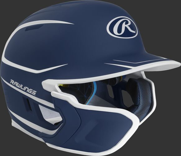 Right angle view of a matte navy/white MACHEXTR Mach Junior helmet with Mach EXT left hand batter face guard extension