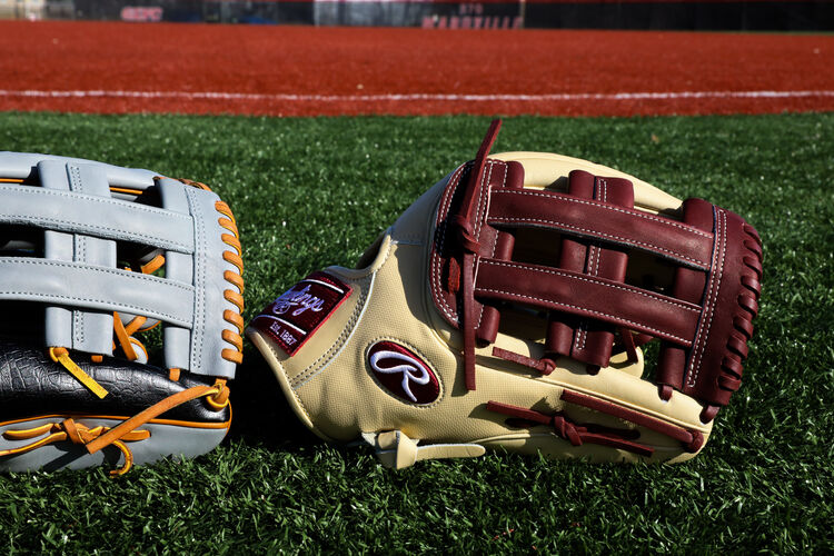 A camel/dark sherry/ Heart of the Hide ColorSync 5.0 outfield glove on a field - SKU: PRO3319-6CSH