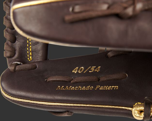 Inside thumb of a Manny Machado Gameday 57 Series glove with a limited edition 40/54 stamp - SKU: PROSNP7-MM13
