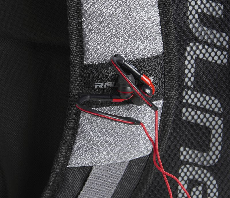 A gray shoulder strap on a R1000 Rawlings Gold Glove Series backpack with headphones attached to the magnet