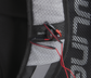 A gray shoulder strap on a R1000 Rawlings Gold Glove Series backpack with headphones attached to the magnet image number null