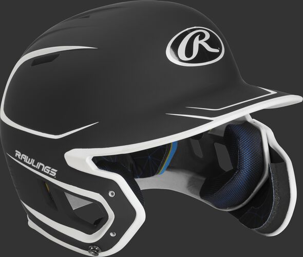 Right angle view of a MACHEXTR Rawlings Mach EXT junior helmet with a two-tone matte black/white shell