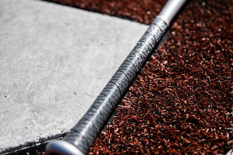 Silver grip of a Rawlings 2020 BBCOR 5150 bat next to home plate - SKU: BBZ53