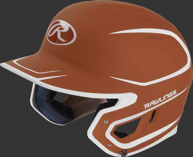 Left angle view of a Rawlings MACH Junior helmet with a two-tone matte orange/white shell