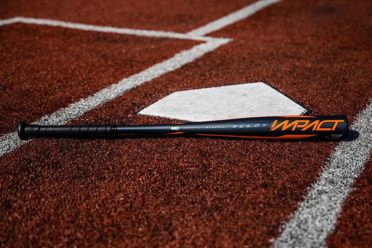A 2020 Impact BBCOR bat lying next to home plate - SKU: BBZI3