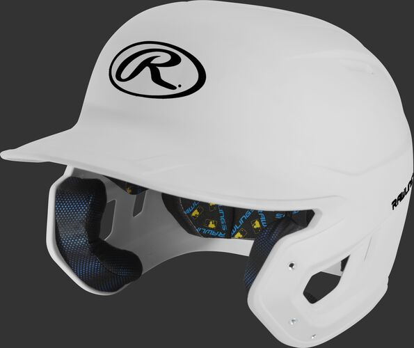 Left angle view of a matte white MCH07A Mach high school/college batting helmet