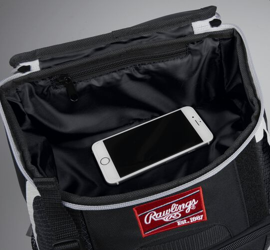 Top accessory pocket of a black R500 equipment backpack holding a phone