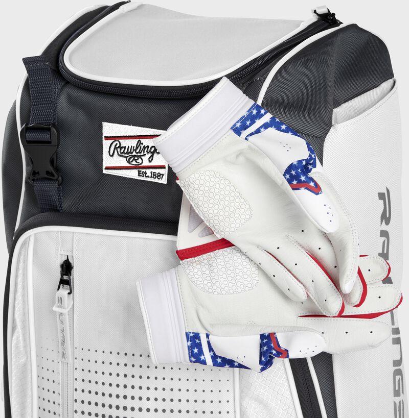 Wallet, keys, and batting gloves in the front valuables pocket of a white Franchise baseball bag - SKU: FRANBP-W