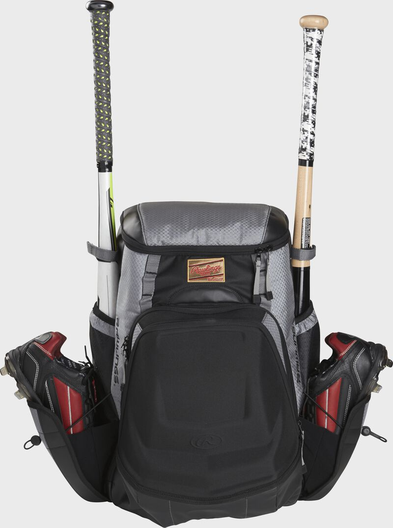 Front of a black/gray R1000 Gold Glove Equipment bag with two cleats and two bats in the side compartments