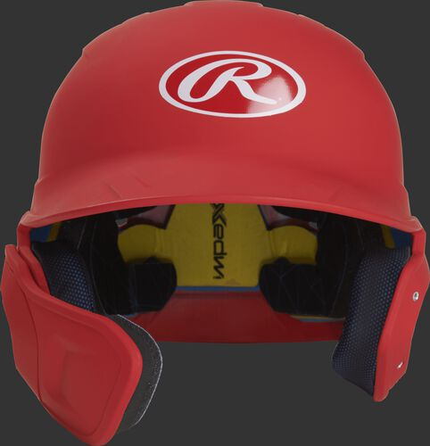 Front of a matte scarlet MACHEXTL high school/college Mach batting helmet with face guard extension for left hand batters