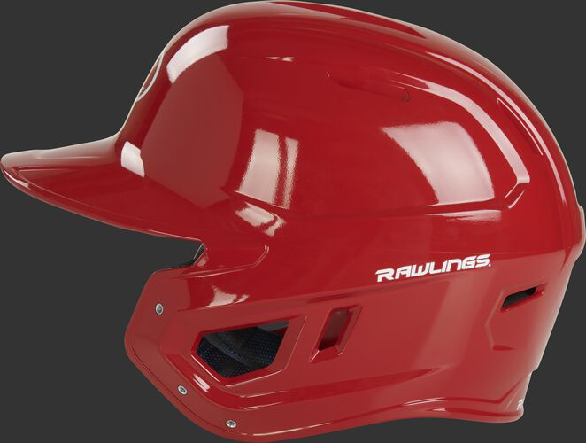 Left side of a scarlet MCC01 Mach baseball helmet compatible with MEXT face guard extension