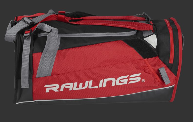 Side of a scarlet R601 Hybrid backpack/duffel players bag with black trim and a white Rawlings logo on the bat sleeve