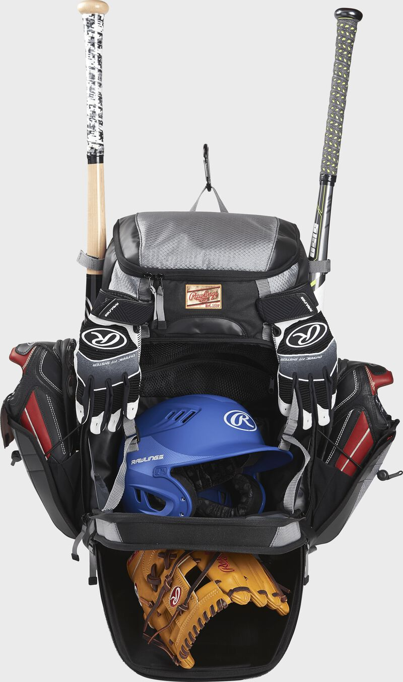 A black/gray R1000 Rawlings Gold Glove bag with the main compartments open and filled with a helmet, glove, bats and cleats