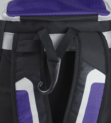 Exterior handle on the back of a black/purple R500 backpack with a hook for hanging it up