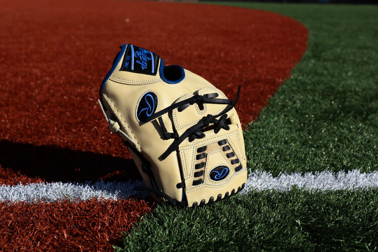 A Rawlings HOH ColorSync 5.0 infield/pitcher's glove standing on its finger tips on a field - SKU: PRO205-30CR