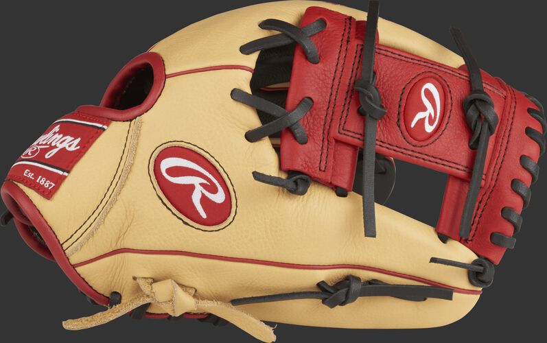 Thumb view of a camel SPL112AR 11.25-inch Select Pro Lite Addison Russel youth infield glove with a scarlet I web