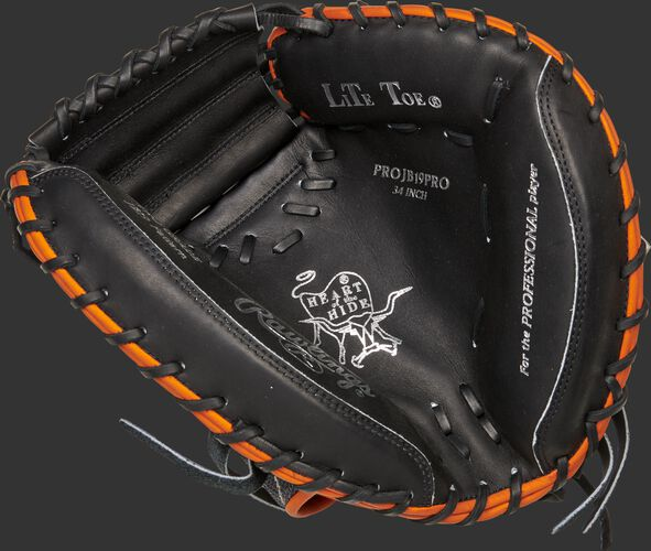 Black palm of a Rawlings Heart of the Hide catcher's mitt with silver stamping and black laces - SKU: PROJB19PRO