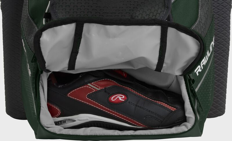 A dark green Rawlings baseball backpack with a cleat in the bottom cleat storage compartment - SKU: IMPLSE-DG