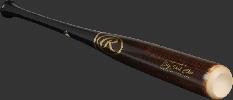 Angled view of a flame tempered/black Big Stick Elite Birch bat with a cupped end and gold accents - SKU: I13RBB