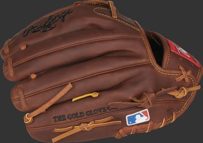Fingers of a timberglaze PRO12-NA28 Nolan Arenado Gameday 57 model with the Official Glove of MLB logo