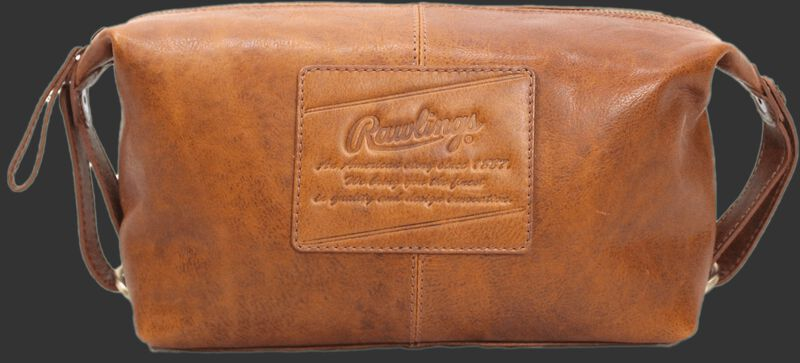 A tan Rugged travel kit with a leather patch sewn on with the Rawlings logo and script text underneath - SKU: V625-202