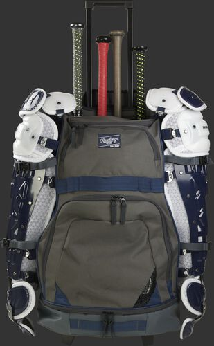 A grey/navy R1801 Rawlings catcher's equipment wheeled backpack with four bats and leg guards secured on the sides