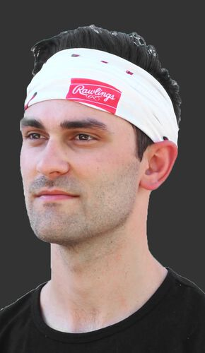 A guy wearing a white baseball stitch multi-functional neck gaiter as a head band - SKU: RC40001-100