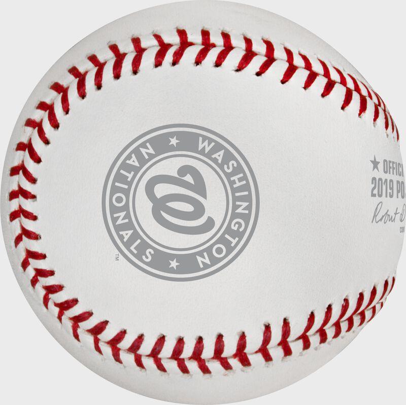 A grey Washington Nationals logo stamped on a NLCS19CHMP Washington Nats' NLCS Champions baseball
