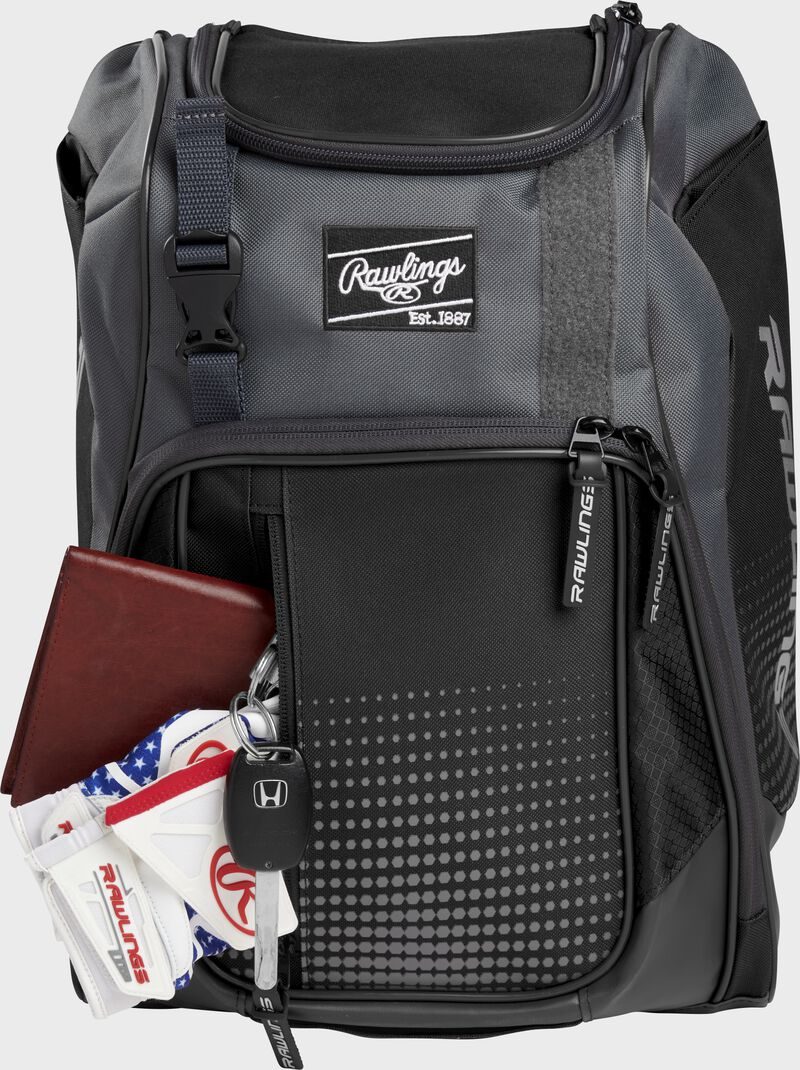 Wallet, keys, and batting gloves in the front valuables pocket of a black Franchise baseball bag - SKU: FRANBP-B