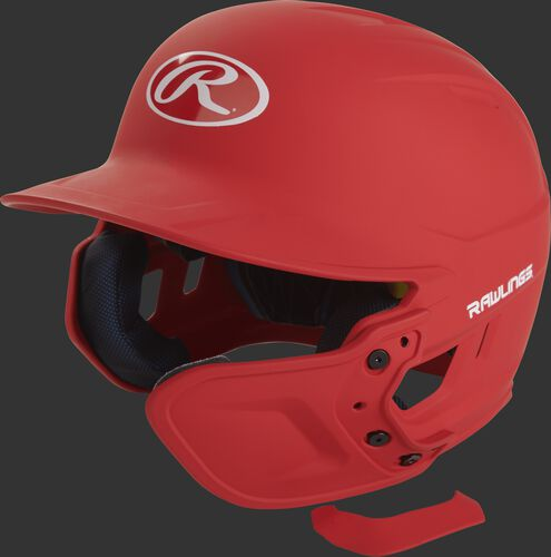 A matte scarlet MEXT attached to a Mach batting helmet showing the hardware