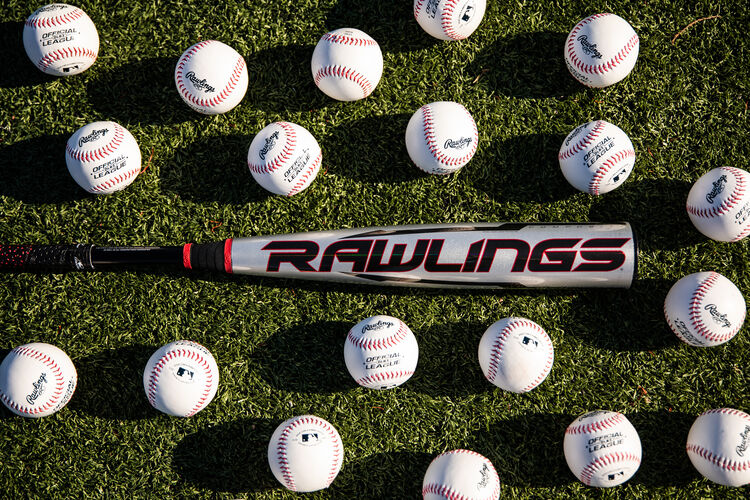 Rawlings logo on the barrel of a USA Quatro Pro bat on a field surrounded by baseballs - SKU: US1Q8