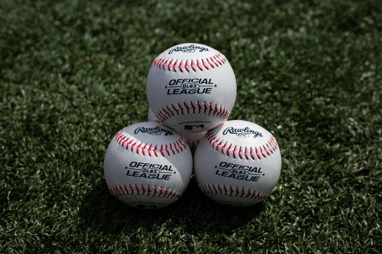 Three Rawlings baseball lying together in a triangle on a field - SKU: OLB3