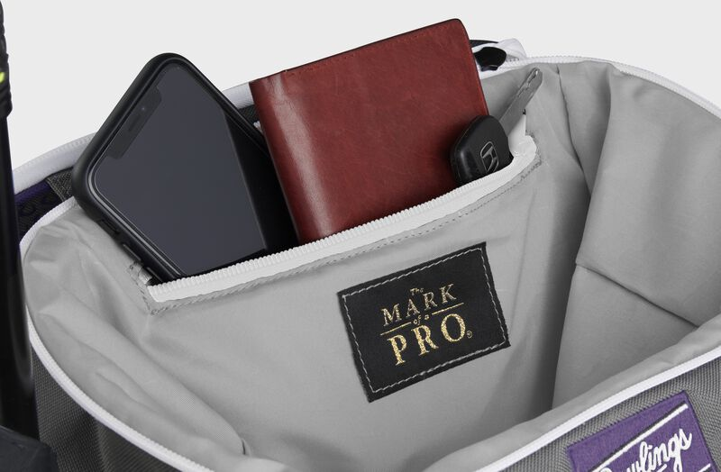 Zippered pocket in the top storage compartment of a purple Impulse backpack with a phone, wallet and keys - SKU: IMPLSE-PU