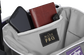 Zippered pocket in the top storage compartment of a purple Impulse backpack with a phone, wallet and keys - SKU: IMPLSE-PU image number null