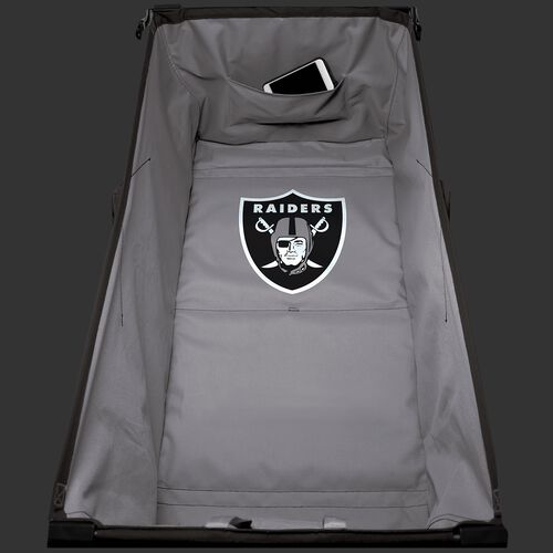 Inside of an Oakland Raiders tailgate wagon with a team logo in the middle SKU #00931072519