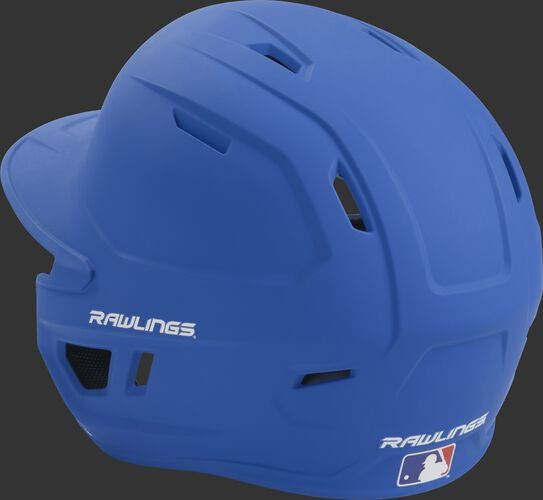 Back left view of a matte royal MACH series batting helmet with air vents