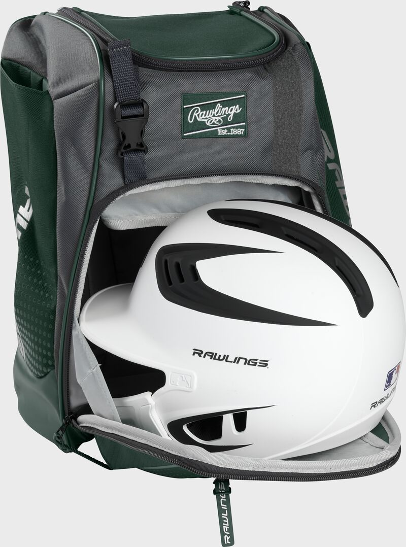A white/black helmet in the main compartment of a dark green Rawlings Franchise backpack - SKU: FRANBP-DG