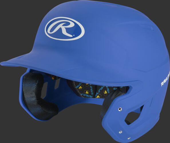 Left angle view of a matte royal MCH07A Mach high school/college batting helmet