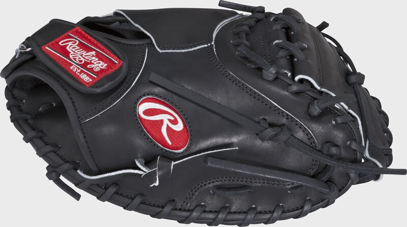 Thumb view of a PROSP13B Heart of the Hide 32.5-inch catcher's mitt with a black one-piece solid web