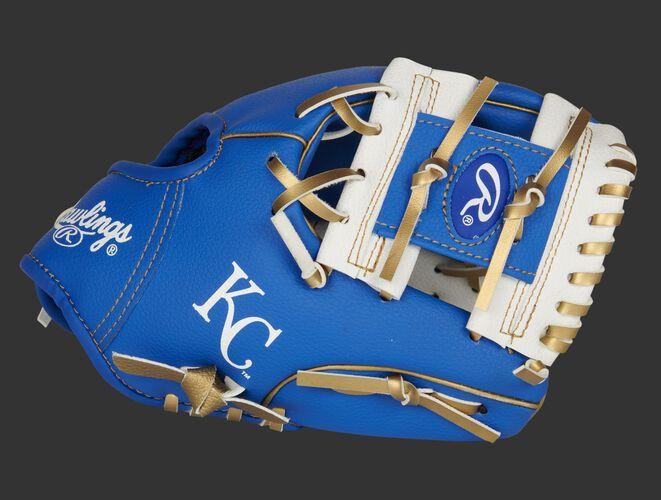 A blue/white Kansas City Royals 10-Inch team logo glove with a white I-web and KC logo on the thumb - SKU: 22000026111