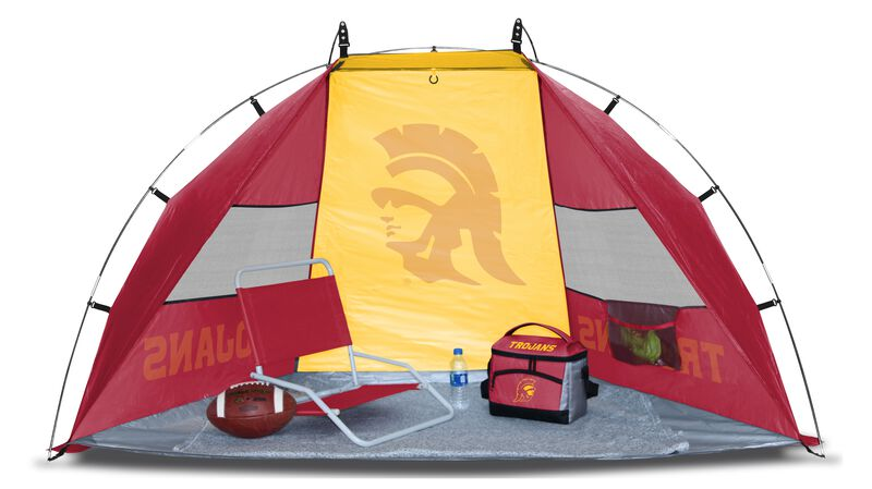 A USC Trojans sideline sun shelter set up with a chair, cooler, football and water bottle - SKU: 00973100111