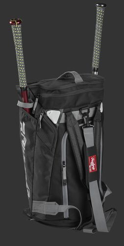 Right angle of a black R601 Hybrid players duffel bag standing up with two bats
