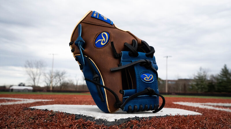 A 2020 Heart of the Hide exclusive infield glove standing up on home plate with a royal I-web - SKU: PRO204W-2TIR