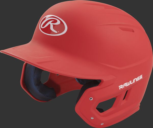 Left angle view of a Rawlings MACH Senior helmet with a one-tone matte scarlet shell